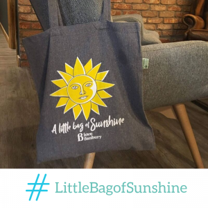 A Banbury BID Little Bag of Sunshine displayed on over a chair.