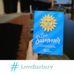 The Love Banbury Summer Guide held up in front of Banbury canal.